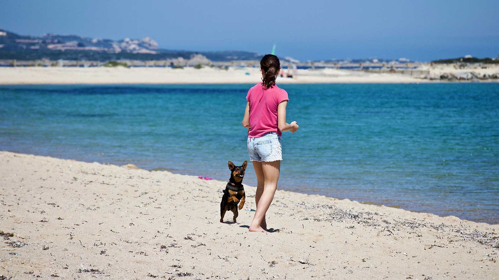girl-dog-beach